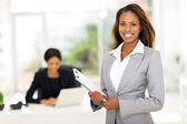 African businesswoman holding clipboard — Zdjęcie stockowe