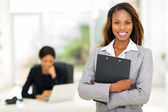 Black business woman holding clipboard  — Foto de Stock