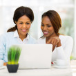 Mid age african mother and daughter using laptop computer — Stock Photo #50605003