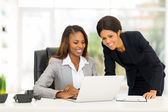 African female colleagues working in office — Stock Photo