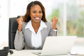 African american businesswoman waving fists — Stock Photo