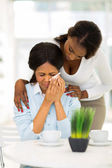 African woman comforting crying mother — Stock Photo