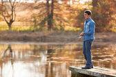Young man fishing — Stock Photo
