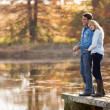 Young couple fishing together — Stock Photo #50610067