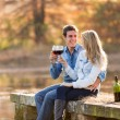 Couple enjoying glass of red wine — Stock Photo #50611635
