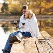 Romantic couple snuggle outdoors in autumn — Stockfoto