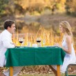 Young couple having romantic dinner outdoors — Stock Photo #50614185