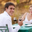 Young man having romantic dinner with girlfriend — Stock Photo