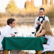 Young couple place dinner order to waitress — Stock Photo #50614445