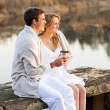 Couple relaxing on a pier — Stock Photo #50614645