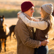 Romantic young couple in the horse farm — Stock Photo