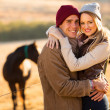 Happy young couple in horse ranch — Stock Photo #50618431