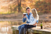 Couple enjoying glass of red wine  — Stock Photo