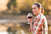 Thoughtful young woman holding wine glass  — Stock Photo