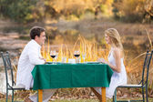 Young couple having romantic dinner outdoors — Stock Photo