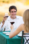 Young man having dinner with his girlfriend — Stock Photo
