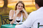 Young woman having dinner with her boyfriend — Stock Photo
