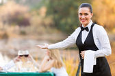 Waitress welcomes customers  — Stock Photo