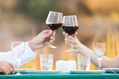 Couple toasting with red wine — Stock Photo