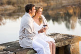 Couple relaxing on a pier — Stock Photo