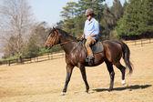 Young man riding a horse — Stock Photo