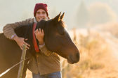 Man hugging his horse — Stock Photo