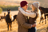 Romantic young couple in the horse farm — Foto Stock