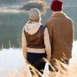 Young couple standing by the lake — Photo