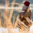 Back view of young couple hugging in winter — Stock Photo