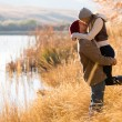 Young couple kissing in autumn — Stock Photo #50622835