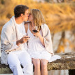 Couple kissing on a pier — Stock Photo #50623455