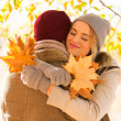 Young woman hugging her boyfriend in fall — Stok fotoğraf