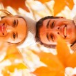 Underneath view of young couple in autumn — Stock Photo #50629477