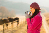Woman drinking coffee in the morning — Stock Photo