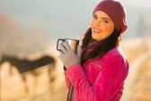 Happy woman having coffee in the morning — Stock Photo