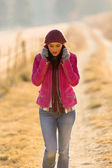 Woman walking outdoors in winter — Foto Stock