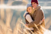 Young couple hugging in autumn morning — Stock Photo