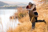 Young couple kissing in autumn — Stock Photo