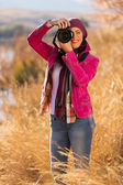 Woman taking photos of winter wildness — Stock Photo