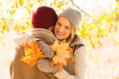 Couple in autumn forest — Stock Photo