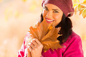 Woman holding autumn leaves — Stock Photo