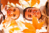 Underneath view of young couple in autumn — Foto Stock