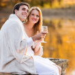 Lovely couple having wine by the lake — Stock Photo