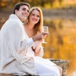Lovely couple having wine by the lake — Stock Photo #50630707