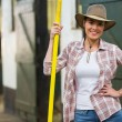 Pretty cowgirl holding pitch fork — Stock Photo #50635011