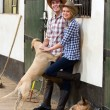 Young horse farming couple in stables — Stock Photo #50639623