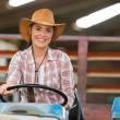 Female farmer driving a tractor — Stock Photo #50639859