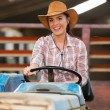 Cowgirl driving tractor — Stock Photo #50639929