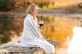 Thoughful woman with a glass of red wine — Stock Photo
