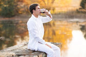 Young man drinking red wine — Foto de Stock